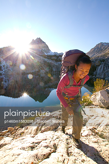 Woman hiking near Lower Lamarck Lake in the eastern Sierras, California                   - p1460m1583098 by Stephen Matera