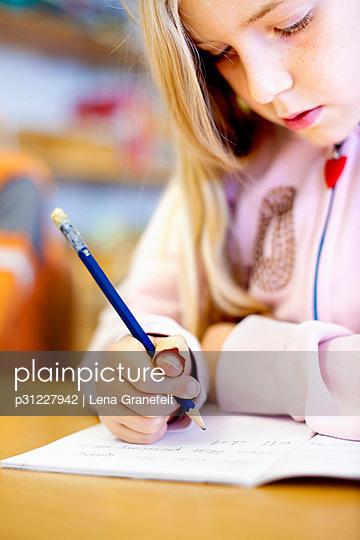 Schoolgirl writing on paper - p31227942 by Lena Granefelt