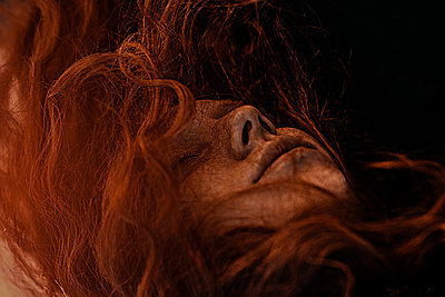 Wind blowing red hair of Caucasian woman - p555m1531638 by Ivan Ozerov