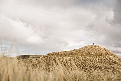 Hiking along a dune at Balnakeil Beach - p1477m2038985 by rainandsalt