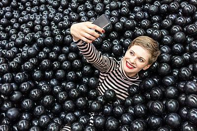 Selfie in ball pool, Liquorice pool - p1332m2055032 by Tamboly