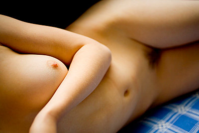 Nude body of young woman - p4130072 by Tuomas Marttila