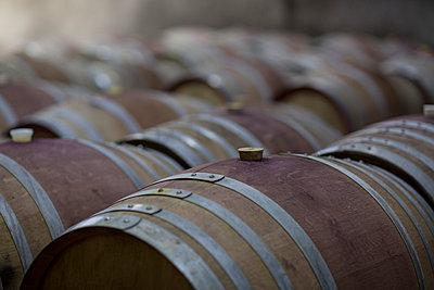 Wine barrels in cellar - p300m1029088f by zerocreatives