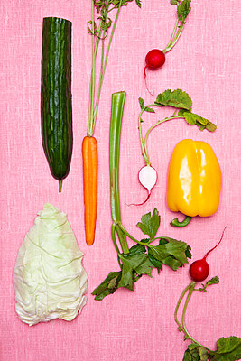 Vegetables on pink background - p312m1121637f by Susanne Walstrom