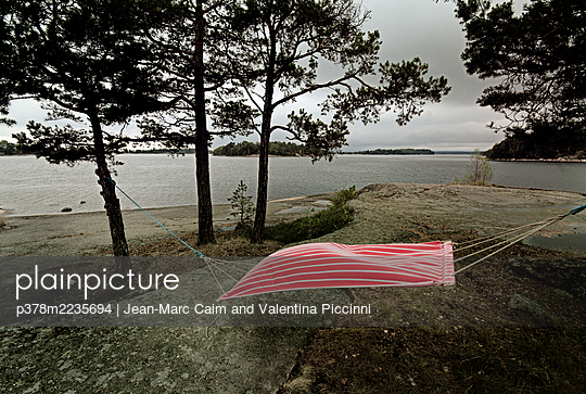 Red hammock - p378m2235694 by Jean-Marc Caim and Valentina Piccinni