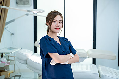 Portrait of beautiful female doctor standing in beauty salon pla - p1166m2269018 by Cavan Images
