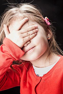 Little girl covering her eyes - p92411872f by Diana Deak