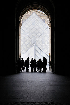 People by the glass pyramid in the Louvre Museum in Paris, France - p1072m829273 by Neville Mountford-Hoare