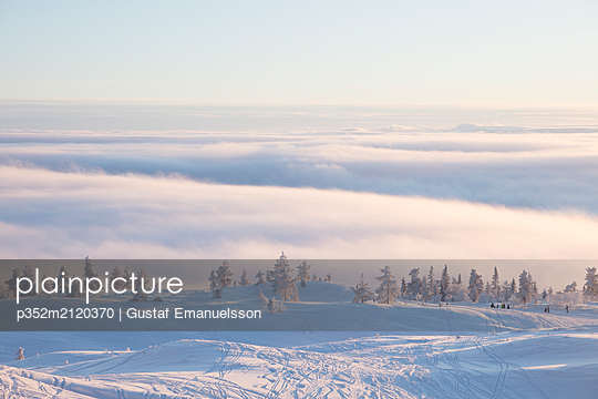 Snowy slope above clouds - p352m2120370 by Gustaf Emanuelsson