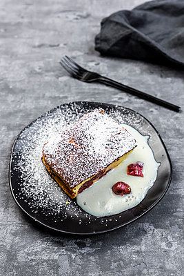 Slice of curd cheese casserole with cherries - p300m2189093 by Sandra Roesch