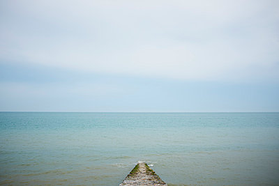 Seascape and wooden pier, Normandy, France - p429m1014487 by Kathleen Finlay