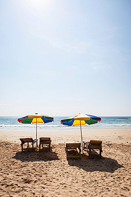 Parasols on the beach - p795m1031502 by Janklein