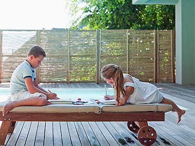 Boy and girl drawing outside - p9244397f by Image Source