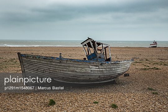 Fishing boat on the beach - p1291m1548067 by Marcus Bastel