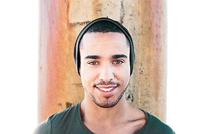 Smiling Hispanic man wearing cap - p1427m2271503 by Eric Raptosh Photography