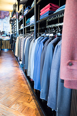Rows of suit jackets hanging in traditional tailors shop - p429m2004284 by G. Mazzarini