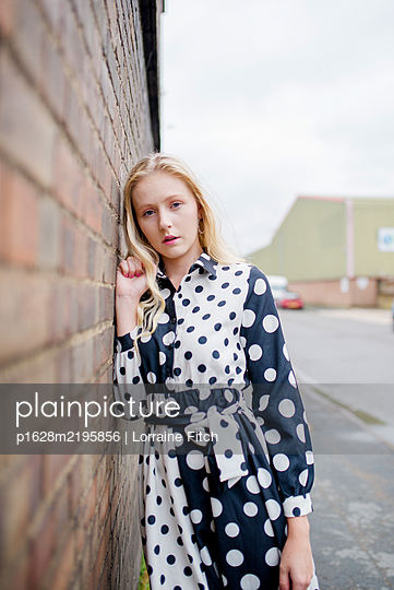 Blonde woman in spotty dress - p1628m2195856 by Lorraine Fitch