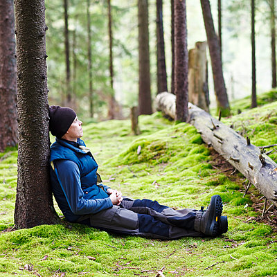 Man relaxing in forest - p312m1063801f by Stefan Isaksson