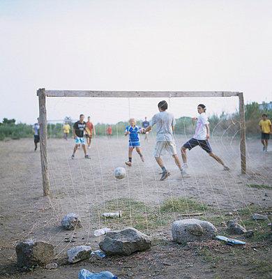 Children playing football - p7090037 by Axel Kohlhase
