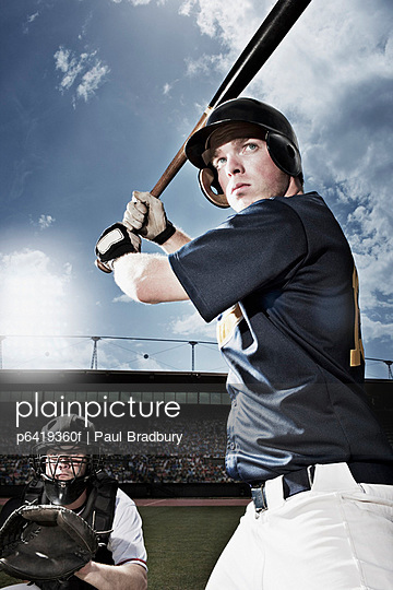 Baseball player swinging baseball bat