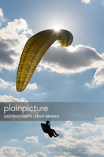 Paraglider ready for landing - p1079m2152575 by Ulrich Mertens