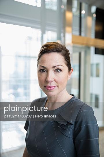 Portrait confident, serious businesswoman