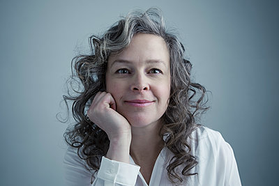 Portrait confident Caucasian mature woman with curly gray hair - p1192m1213215 by Hero Images