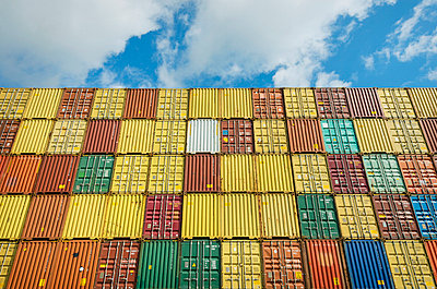 Shipping containers stacked together - p429m696578 by Mischa Keijser