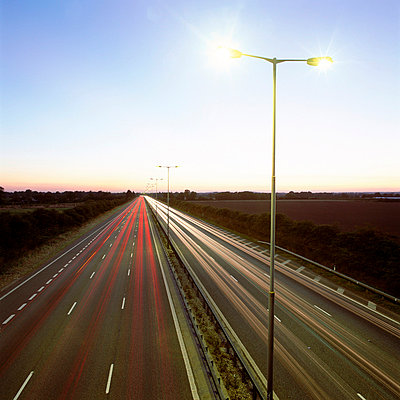 Head and tail-lights on motorway - p92410887f by Image Source