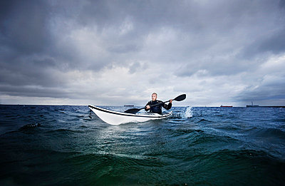 Man in kayak - p42913683f by Soren Hald