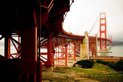 The Golden Gate Bridge shot from below on a foggy afternoon in San Francisco, California. - p1424m1501294 by Noah Couser