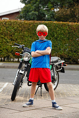 Superman and motorbike - p249m970497 by Ute Mans