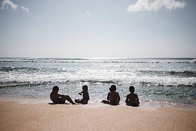 Children relaxing on beach - p1290m1168825 by Fabien Courtitarat