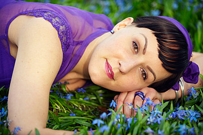 Woman lying on a field of flowers - p5560154 by Wehner