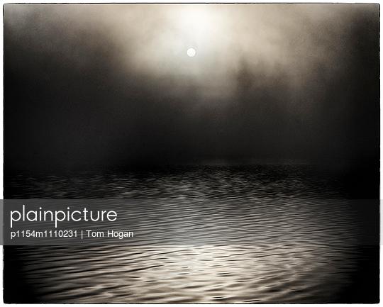 Full moon with fog - p1154m1110231 by Tom Hogan