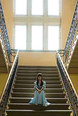 Woman in stairwell - p427m2039039 by R. Mohr