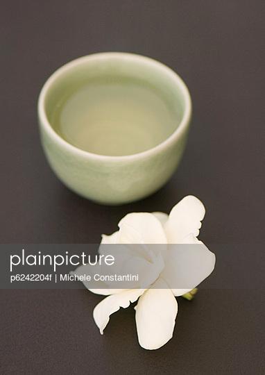 Bowl and gardenia flower