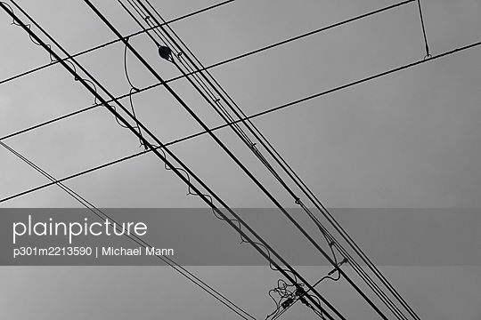 Cable car lines below overcast sky - p301m2213590 by Michael Mann