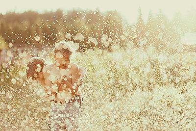 Happy boys on meadow - p312m2080066 by Matilda Holmqvist