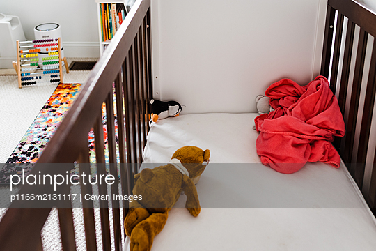 Toys in child's crib - p1166m2131117 by Cavan Images