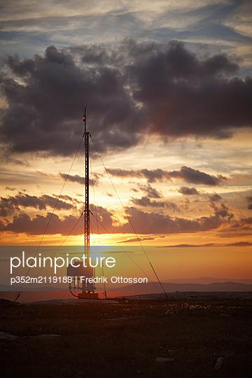 Silhouette of telecommunication antenna at sunset - p352m2119189 by Fredrik Ottosson