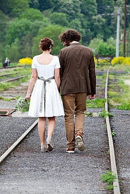 Bridal couple jon the move, back view - p300m980197 by Nabiha Dahhan