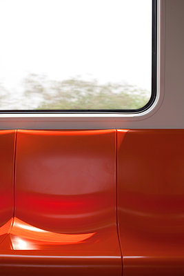 Orange-coloured seat bench in metro - p817m1586762 by Daniel K Schweitzer