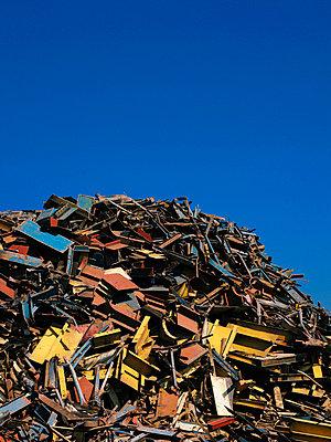 Scrap metal piled in junkyard - p42916989 by Charlie Fawell