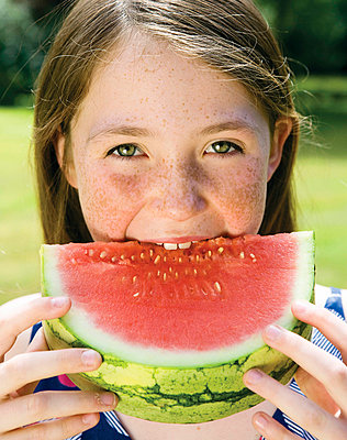 Girl eating a watermelon - p4293250f by Karan Kapoor