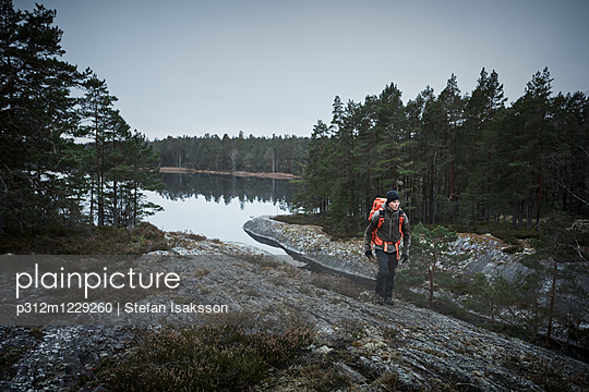 Hiker at water - p312m1229260 by Stefan Isaksson
