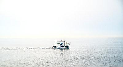 Fishing trawler in the sea - p1082m2289274 by Daniel Allan