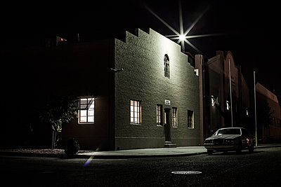 Building And Car Under A Street Light - p1291m1548118 by Marcus Bastel