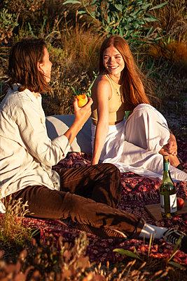 Teenage couple has a summer picnic - p1640m2242160 by Holly & John