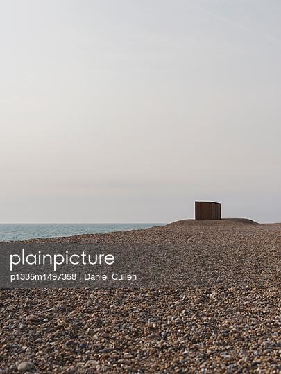 Wooden Hut on Pebble Beach looking over Ocean - p1335m1497358 by Daniel Cullen